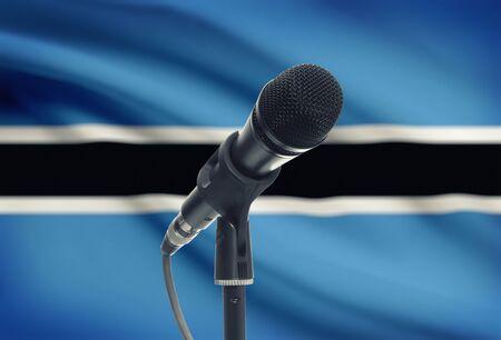botswanan: Microphone with national flag on background series - Botswana