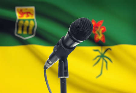 Microphone with Canadian province flag on background series - Saskatchewan