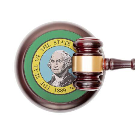 Wooden judge gavel with USA state flag on sound block - Washington
