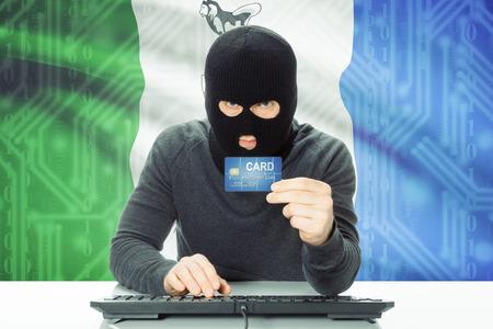 money risk: Hacker with Canadian province flag on background - Yukon