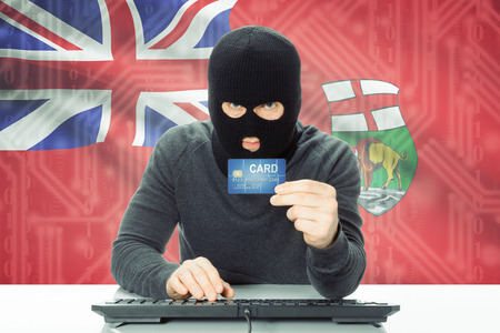 manitoba: Hacker with Canadian province flag on background - Manitoba