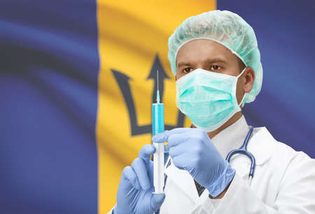 barbadian: Doctor with syringe in hands and flag on background - Barbados
