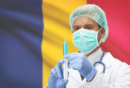 chadian: Doctor with syringe in hands and flag on background - Chad