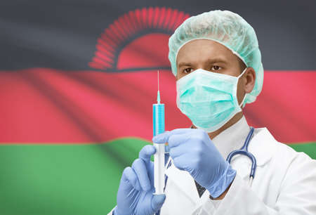 malawian: Doctor with syringe in hands and flag on background - Malawi
