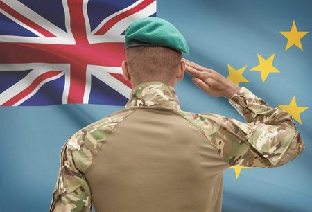 Dark-skinned soldier in hat facing national flag series - Tuvalu