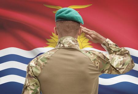 Dark-skinned soldier in hat facing national flag series - Kiribati