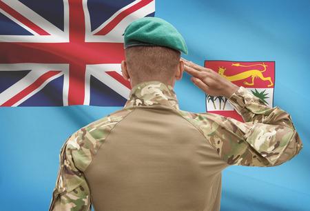 Dark-skinned soldier in hat facing national flag series - Fiji