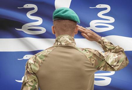 troop: Dark-skinned soldier in hat facing national flag series - Martinique