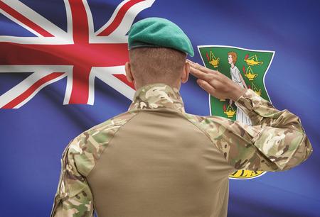 virgin islands: Dark-skinned soldier in hat facing national flag series - British Virgin Islands Stock Photo