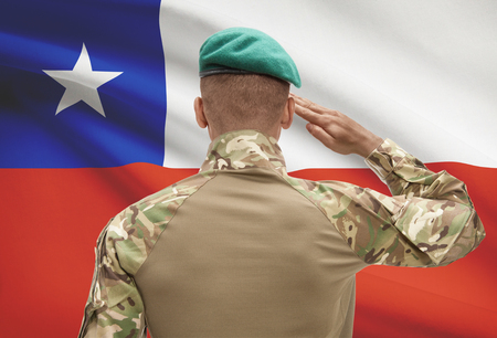 Dark-skinned soldier in hat facing national flag series - Chile