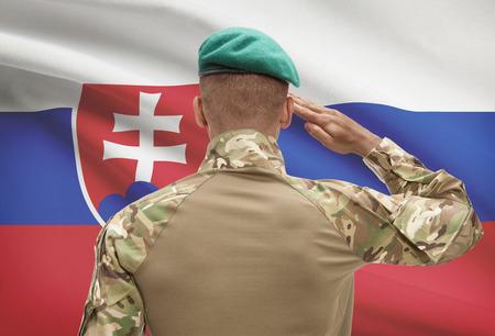 Dark-skinned soldier in hat facing national flag series - Slovakia