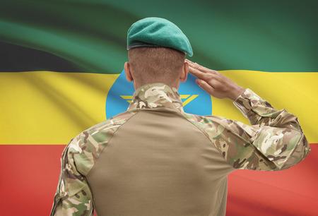 national flag ethiopia: Dark-skinned soldier in hat facing national flag series - Ethiopia