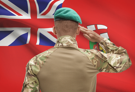 Dark-skinned soldier in hat facing Canadian province flag series - Manitoba