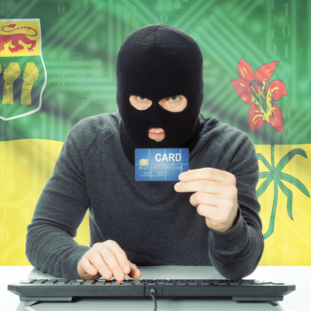 money risk: Hacker with Canadian province flag - Saskatchewan