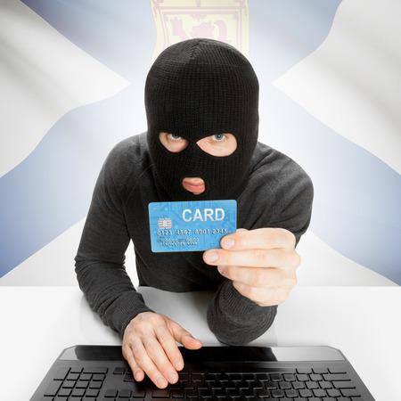 nova scotia: Hacker holding credit card and Canadian province flag - Nova Scotia