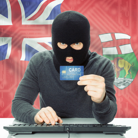 money risk: Hacker with Canadian province flag - Manitoba