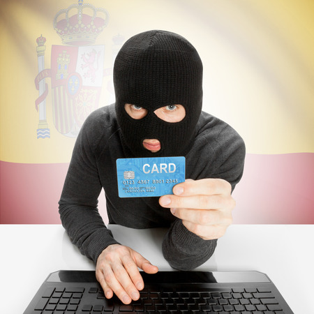 cybercrime: Cybercrime concept with flag - Spain