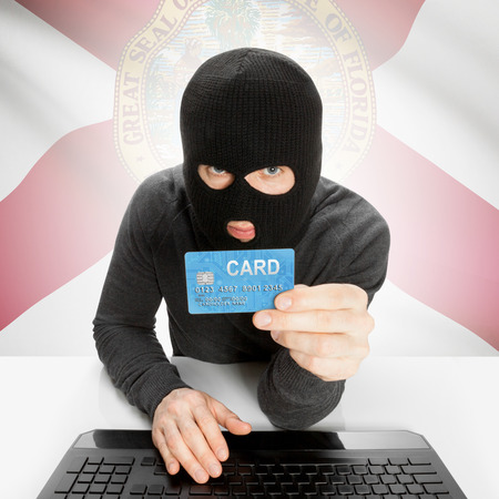 floridian: Hacker in black mask with USA state flag - Florida