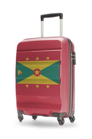 grenada: Suitcase painted into national flag - Grenada Stock Photo