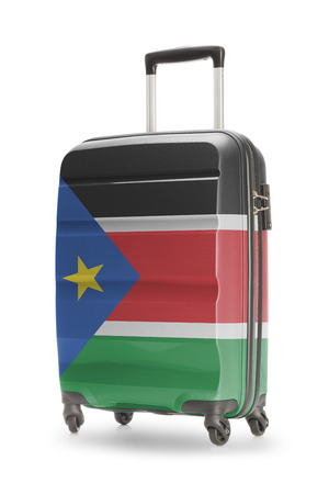 south sudan: Suitcase painted into national flag - South Sudan