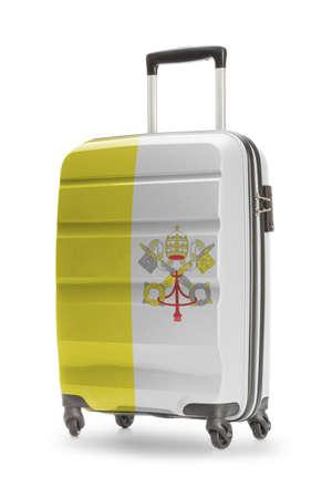 ciudad del vaticano: Suitcase painted into national flag - Vatican City Foto de archivo