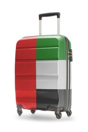 united arab emirates: Suitcase painted into national flag - United Arab Emirates