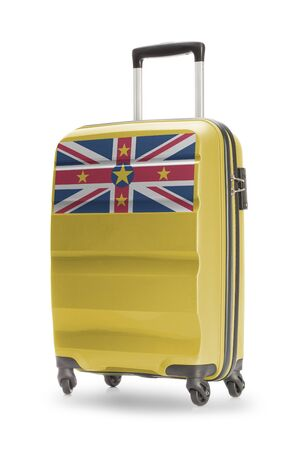 niue: Suitcase painted into national flag - Niue Stock Photo