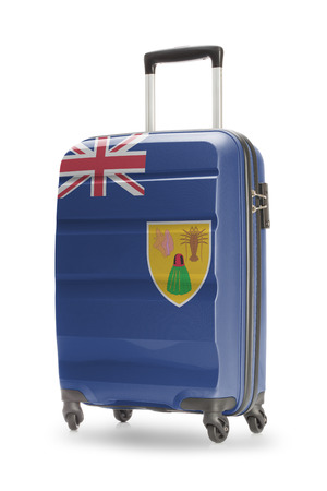 the turks: Suitcase painted into national flag - Turks and Caicos Islands Stock Photo