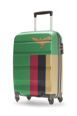 zambian flag: Suitcase painted into national flag - Zambia Stock Photo