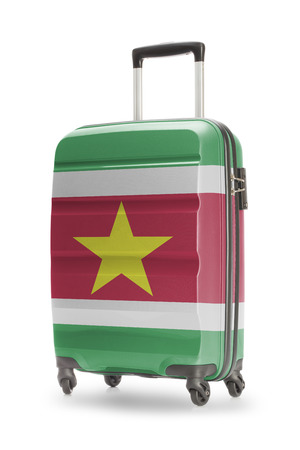 suriname: Suitcase painted into national flag - Suriname