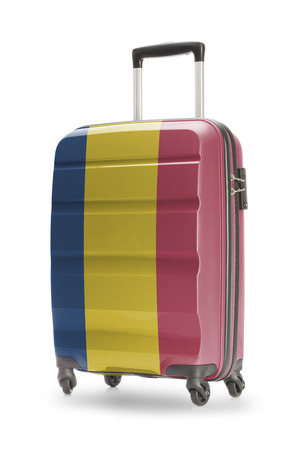 chadian: Suitcase painted into national flag - Chad Stock Photo