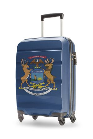michigan flag: Suitcase painted into US state flag - Michigan Stock Photo