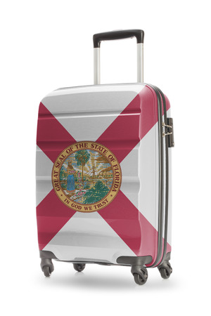 floridian: Suitcase painted into US state flag - Florida Stock Photo