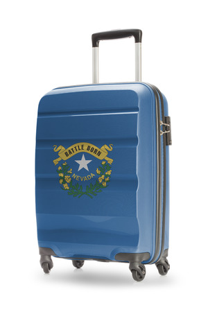 nevada: Suitcase painted into US state flag - Nevada Stock Photo