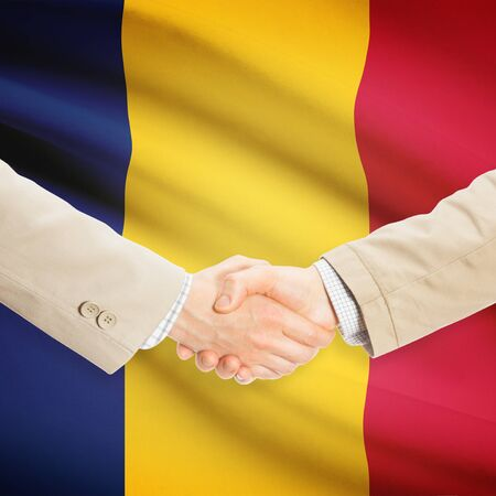chadian: Businessmen shaking hands with flag on background - Chad Stock Photo