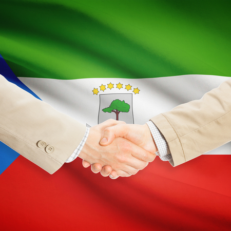 equatorial: Businessmen shaking hands with flag on background - Equatorial Guinea