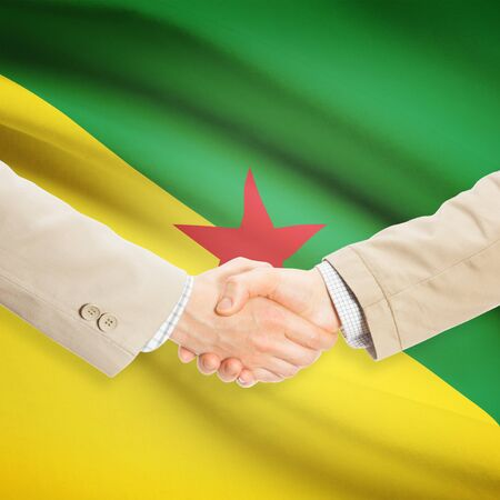 Businessmen shaking hands with flag on background - French Guiana Stock fotó