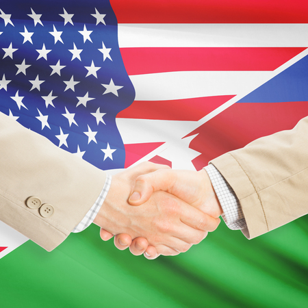 azeri: Businessmen shaking hands - United States and Azerbaijan Stock Photo