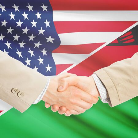 malawian flag: Businessmen shaking hands - United States and Malawi
