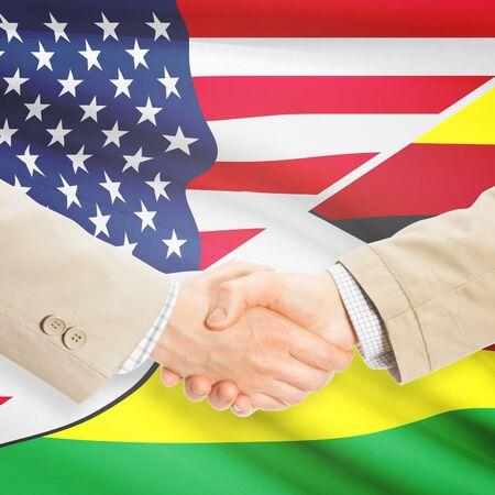 zimbabwe: Los hombres de negocios dándose la mano - Estados Unidos y Zimbabwe Foto de archivo