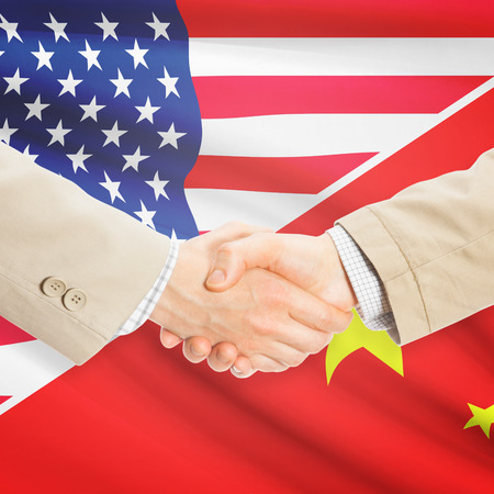 Businessmen shaking hands - United States and China Фото со стока