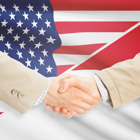 monegasque: Businessmen shaking hands - United States and Monaco