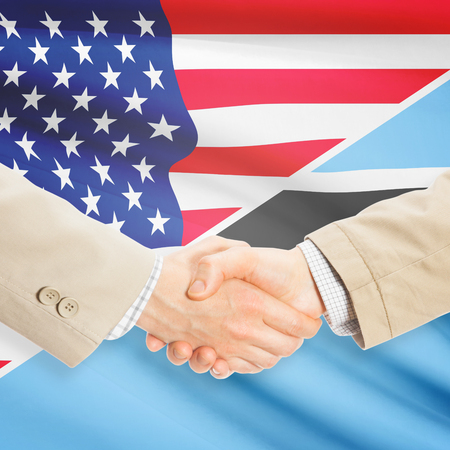 botswanan: Businessmen shaking hands - United States and Botswana