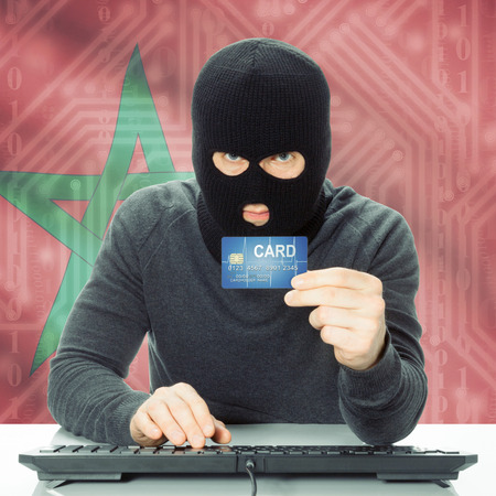 cybercrime: Cybercrime concept with flag on background - Morocco Stock Photo