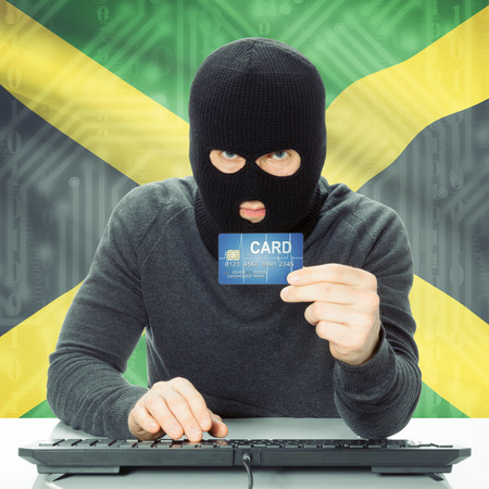 jamaican man: Cybercrime concept with flag on background - Jamaica