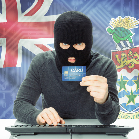 cayman islands: Cybercrime concept with flag on background - Cayman Islands Stock Photo
