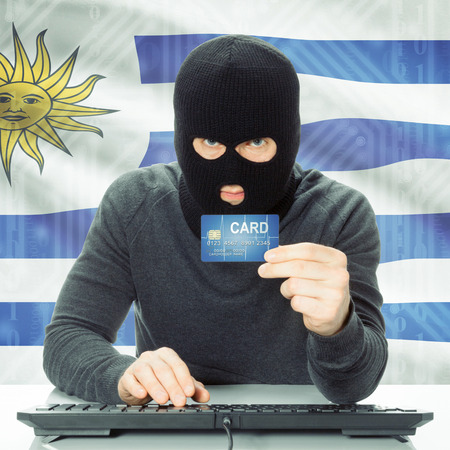 cybercrime: Cybercrime concept with flag on background - Uruguay Stock Photo