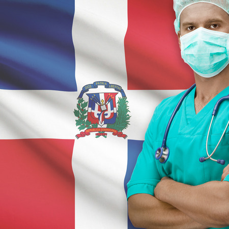 dominican republic: Surgeon with flag on background - Dominican Republic