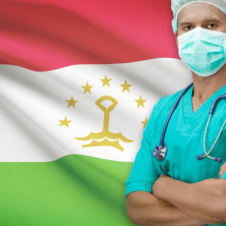 tajikistan: Surgeon with flag on background - Tajikistan