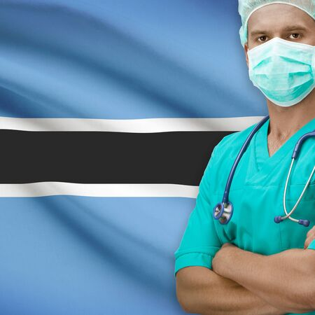 botswanan: Surgeon with flag on background - Botswana Stock Photo